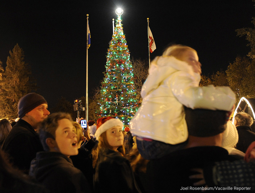 . Kids of all ages look skyward for Santa Claus as the as the lights on the Vacaville Christmas Tree glow during the 28th annual Merriment on Main celebration on Tuesday, November 30, 2010. Joel Rosenbaum/jrosenbaum@thereporter.com