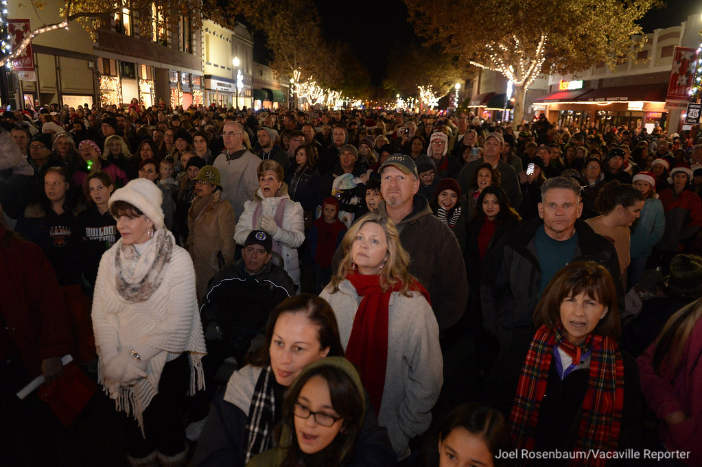 . Crowds gather shoulder-shoulder on  Main Street in downtown Vacaville as they wait for the community Christmas Tree to be lit and for the arrival of Santa during the 33rd annual Merriment On Main. Joel Rosenbaum -- The Reporter