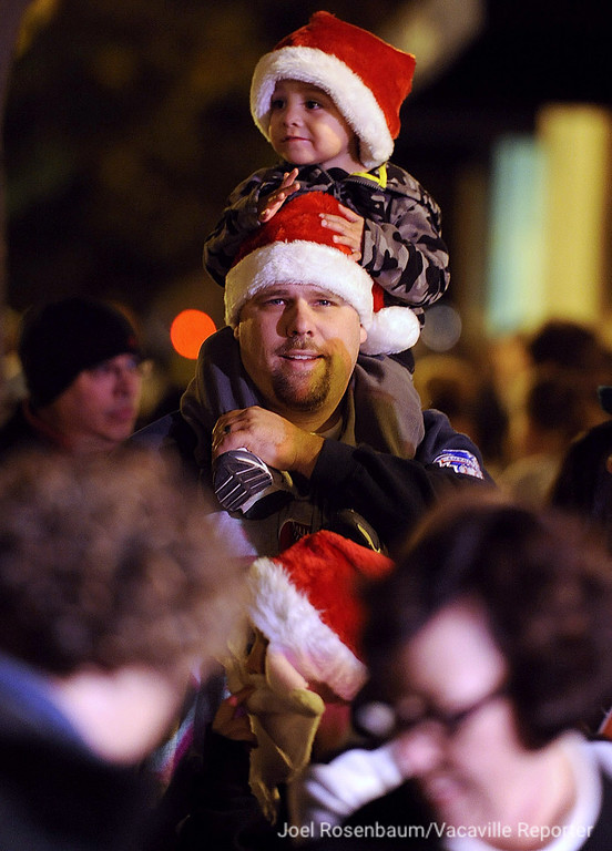 . Eric Haven, 2 of Vacaville gets a birds-eye view of the lighting of the Vacaville Christmas Tree during the 28th annual Merriment on Main celebration on Tuesday, November 30, 2010. Joel Rosenbaum/jrosenbaum@thereporter.com