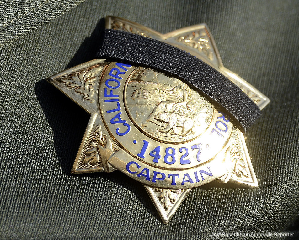 . The badge of California Highway Patrol Captain Tim Pearson, commander of the Hayward area office is wrapped in a memorial band for Officer Andrew J. Camilleri, Sr. who was killed Christmas Eve.