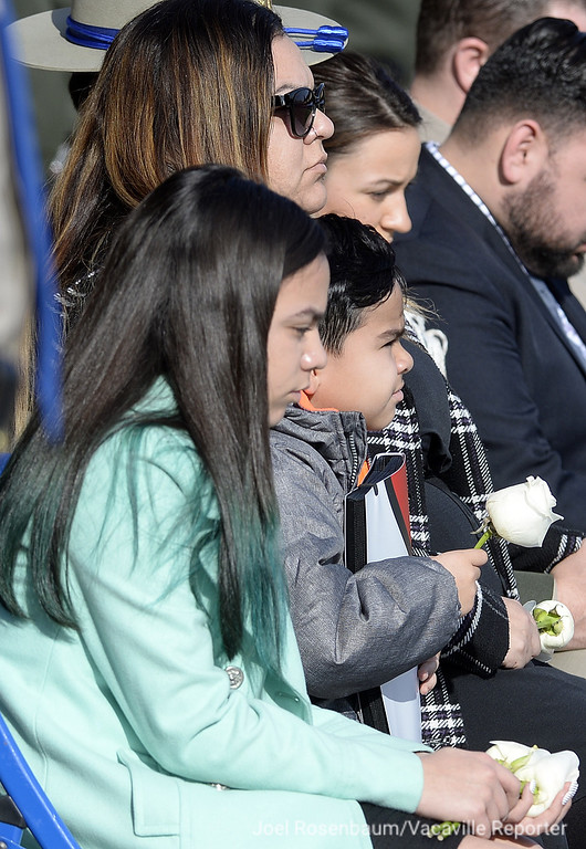 . Rosanna Camilleri (right) sits with her children, Eliizabeth, 12 and Andrew, 6 at a bell toll ceremony for her husband, Andrew Camilleri Sr. a California Highway Patrol Officer who was killed on Christmas Eve.