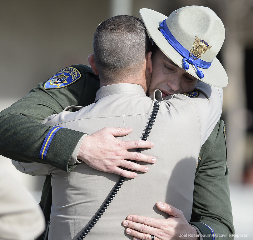 . California Highway Patrol Officer Johnathan Velasquez is comforted by a colleague at the conclusion of a bell toll tribute ceremony for his partner, Andrew Camilleri Sr Wednesday at the CHP Academy in West Sacramento. Camilleri  was killed while he and Velasquez were struck  in their patrol vehicle by a suspected impaired driver on an on-ramp to southbound Interstate 880 in Hayward Christmas Eve.