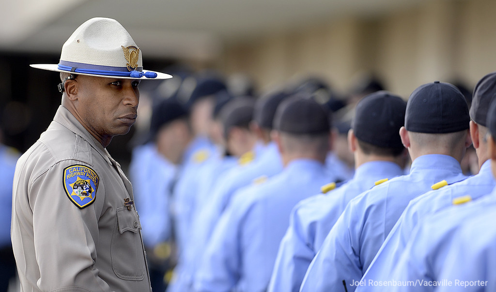. California Highway Patrol cadets march into the quad under the eyes of one of their academy instructors before a a bell toll ceremony for officer Andrew Camilleri Sr. Wednesday at the CHP Academy in West Sacramento.