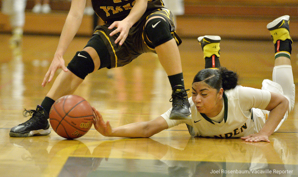 . Vanden\'s Myli Martinez dives on the floor to recover a loose ball from St. Francis High School\'s Paige Uyehara during the fourth quarter of the Vikings 77-42 rout of the Lancers in the semifinals of the NorCal Regionals of the CIF State Basketball Championships Tuesday at Vanden. The Lady Vikes will host NorCal Finals Saturday against Miramonte High School.