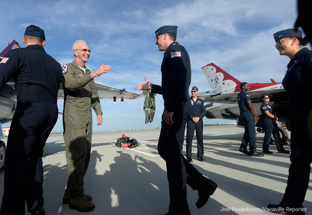 ". Captain Chesley ""Sully\"" Sullenberger greets all the members of the United States Air Force Thunderbirds after he flew with them Thursday at Travis Air Force Base."