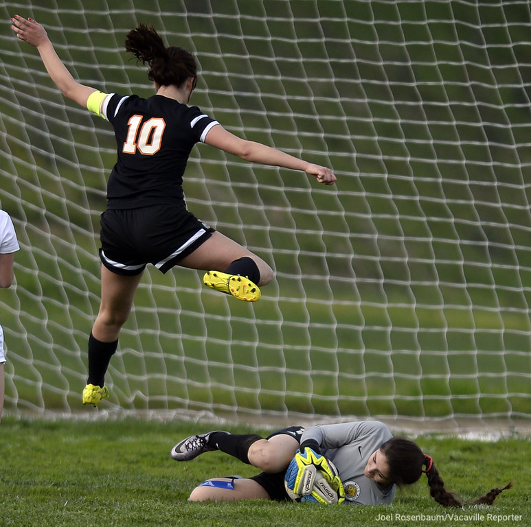 . Vaca High\'s Tayler Holbein leaps over Wood keeper, Madison Del Rio to avoid colliding with her as she makes a save on her shot during the first half of the Bulldogs\' 3-0 victory over the Wildcats Wednesday at Wood.