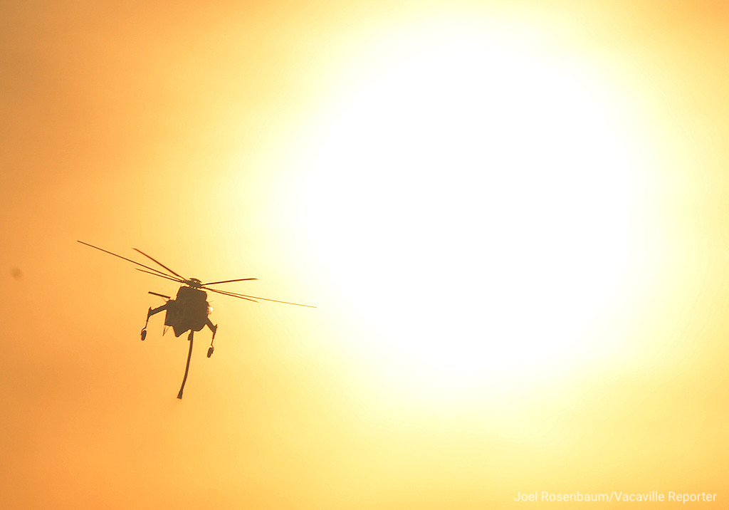 . A Sikorsky S-64 Skycrane makes its approach towards the head of the Atlas Fire burning out of control in the hills above Green Valley late Tuesday afternoon.