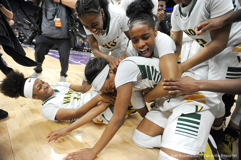 . Vanden�s Julia Blackshell-Fair is mobbed by her teammates as they celebrate their 64-61 victory over Mater Dei High School in the CIF Girls Division II State Championship Saturday at the Golden 1 Center in Sacramento.
