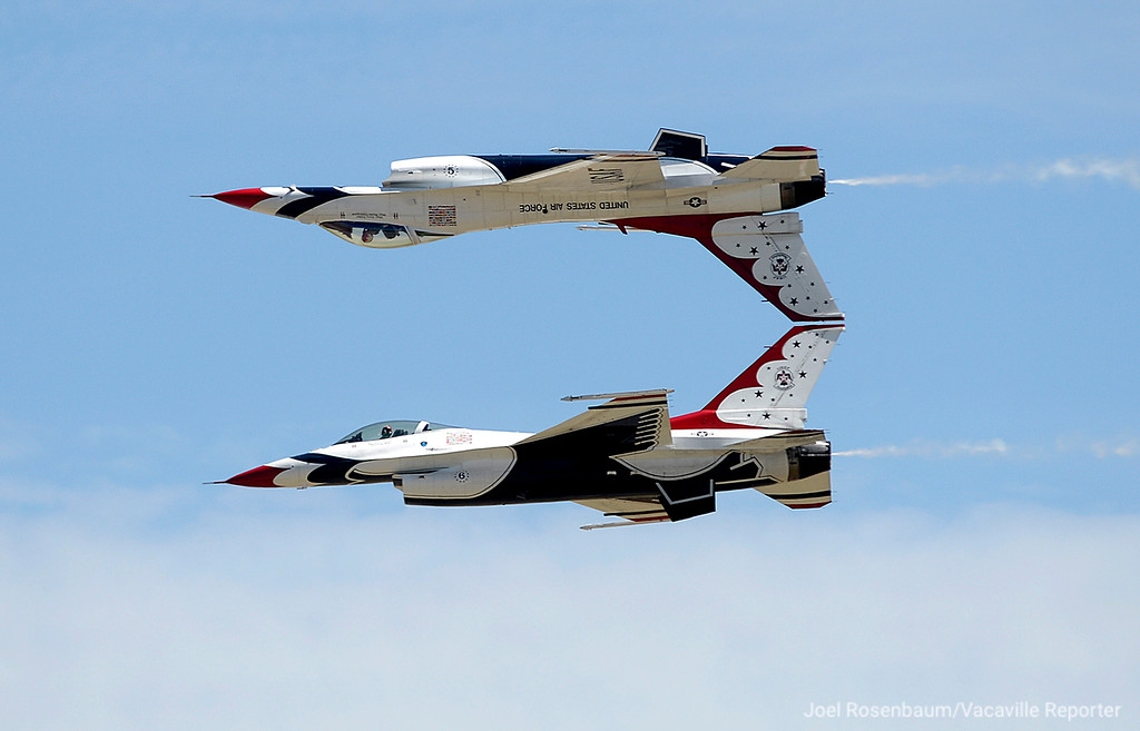 . Thunderbirds 5, piloted by Major Alex Turner (left) and Thunderbird 6 piloted by Major Whit Collins perform the Calypso pass during their show Friday at Travis Air Force Base Make A Wish kids.