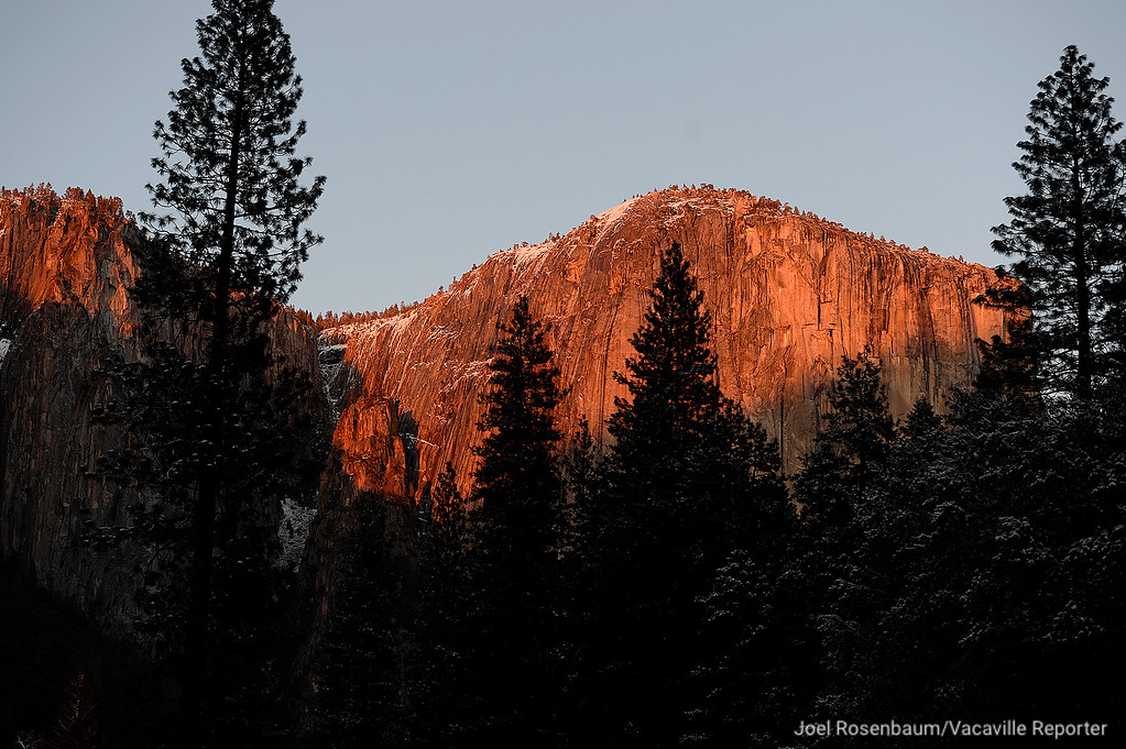 . The light from the setting sun is reflected off the granite cliffs of El Capitan.
