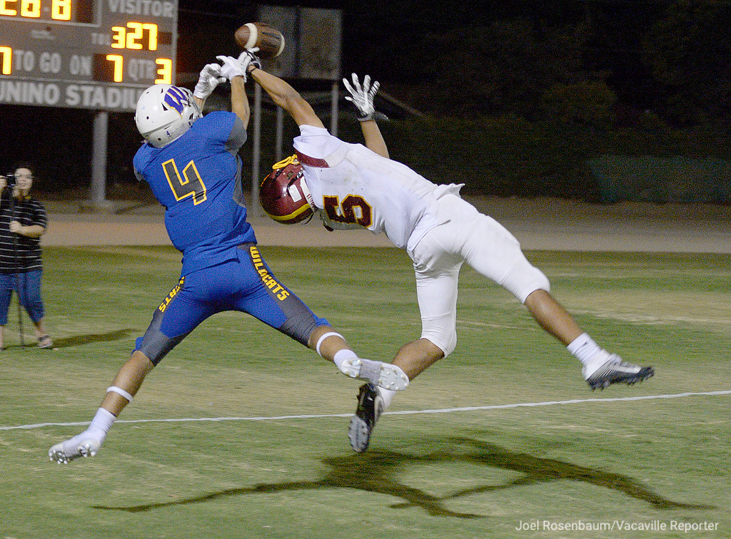 . Will C. Wood High wide receiver, Zach Shane has a possible touchdown pass knocked away by Liberty High cornerback, Devon Wills during the third quarter of the Wildcats\' 34-23 loss to the Lions Friday at Tom Zunino Stadium.