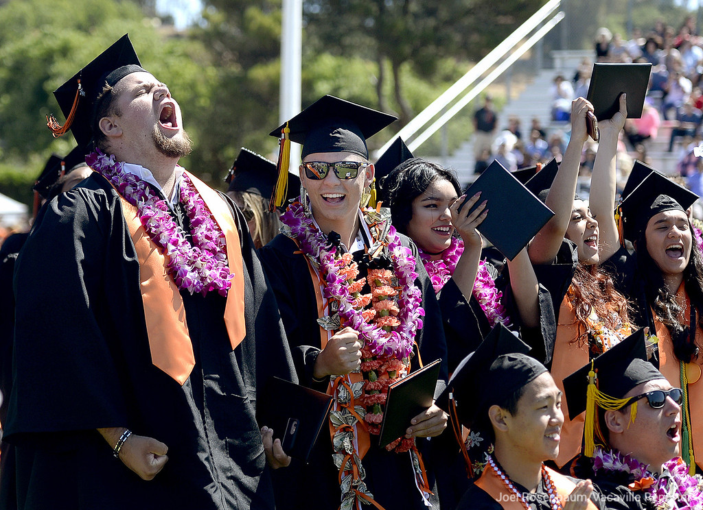 . Members of the Vacaville High School graduating class of 2017 including, Kyle Clements (left) and Troy Claunch celebrate as Stephanie Zuniga, the final member of the senior class walks across the stage to receive her diploma during commencement exercises Saturday at Tom Zunino Stadium.