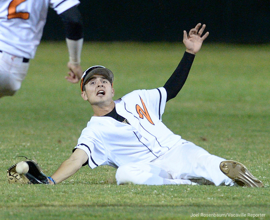 . Vacaville High outfielder, Dylan Lamb has the ball pop out of his glove as he tried to make a sliding catch in shallow centerfield during the eighth inning rally of their 7-3 loss to Del Oro High School in the CIF Sac Joaquin Section Division 1 North Playoffs Thursday at Union Stadium on the campus of Sacramento City College.