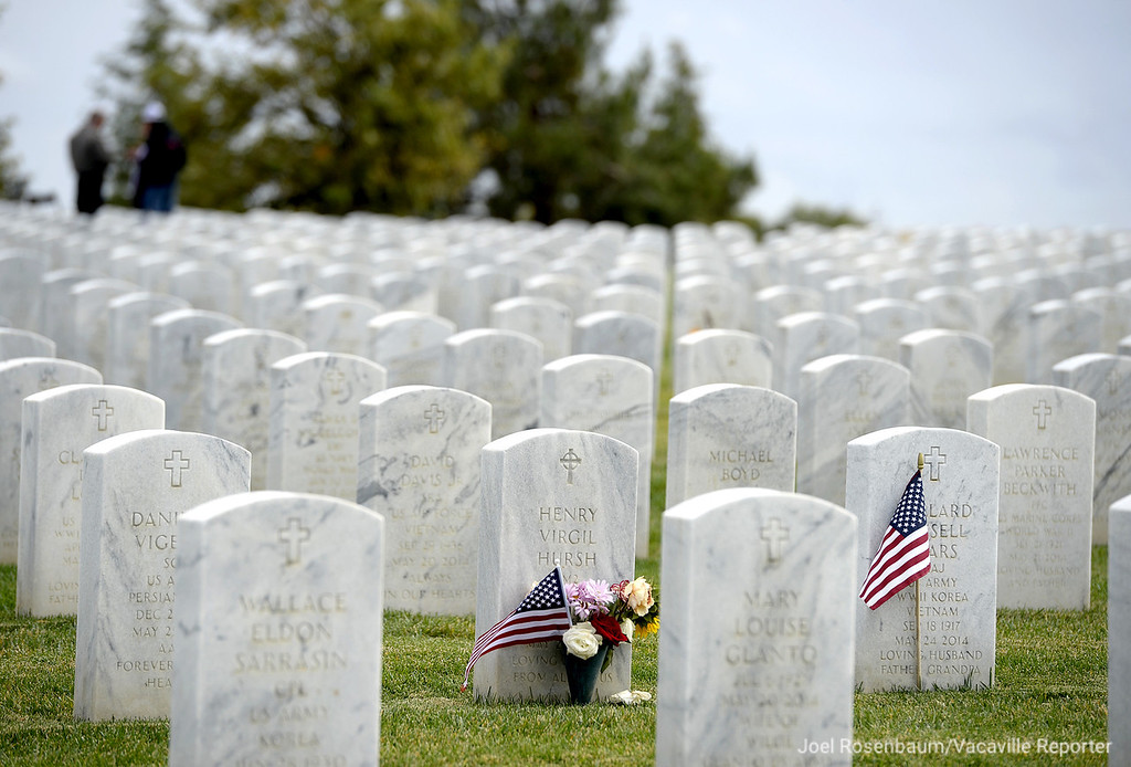 ". Small American flags placed at two grave markers flutter in the fall breeze Friday at the Sacramento Valley National Cemetery. First observed  as ""Armistice Day on November 11, 1919, the first anniversary of the end of World War I, it became a national holiday in 1926."