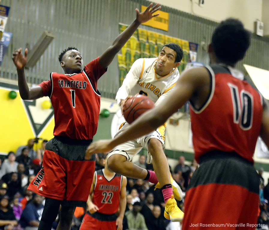 . Vanden\'s DJ Staley drives to the bucket between the double-team of Fairfield High\'s Shakir Howard (1) and Devin Ross-Reed during the thrid quarter of the Vikings 64-44 rout of the Falcons Wednesday at Vanden High. Staley scored 20 points in the victory which also put them into sole possession of first place in the SCAC.
