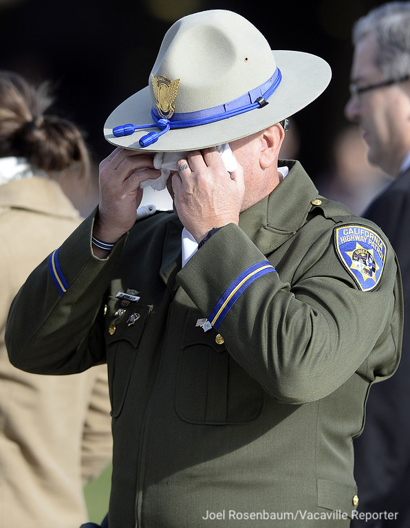 . California Highway Patrol Officer and Honor Guard member Mike Paulson wipes tears from his eyes after comforting CHP Officer Johnathan Velasquez following a Memorial Bell Tolling Ceremony for Velasquez\'s partner, Officer Andrew Camilleri Sr. Wednesday at the CHP Academy in West Sacramento. Joel Rosenbaum -- The Reporter