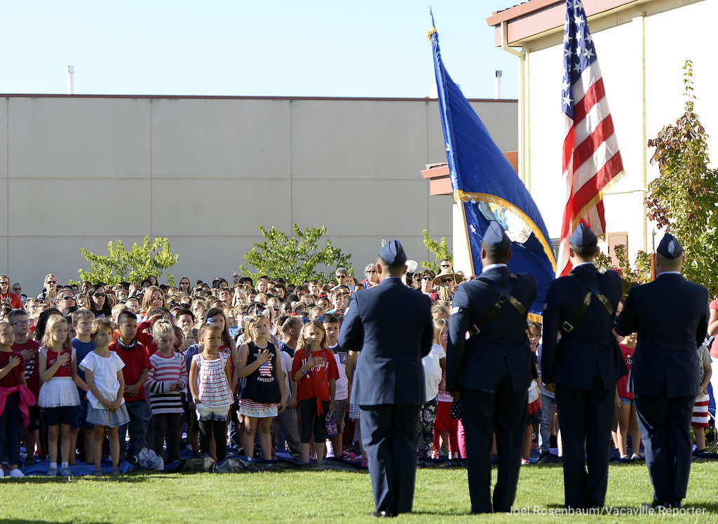 . Members of the Travis Air Force Base Honor Guard preset the colors to begin a 9/11 ceremony at the Airman and Family Readiness Center Tuesday  to remember and pay tribute to those that lost their lives during the 9/11 terrorists attack 17 years ago.