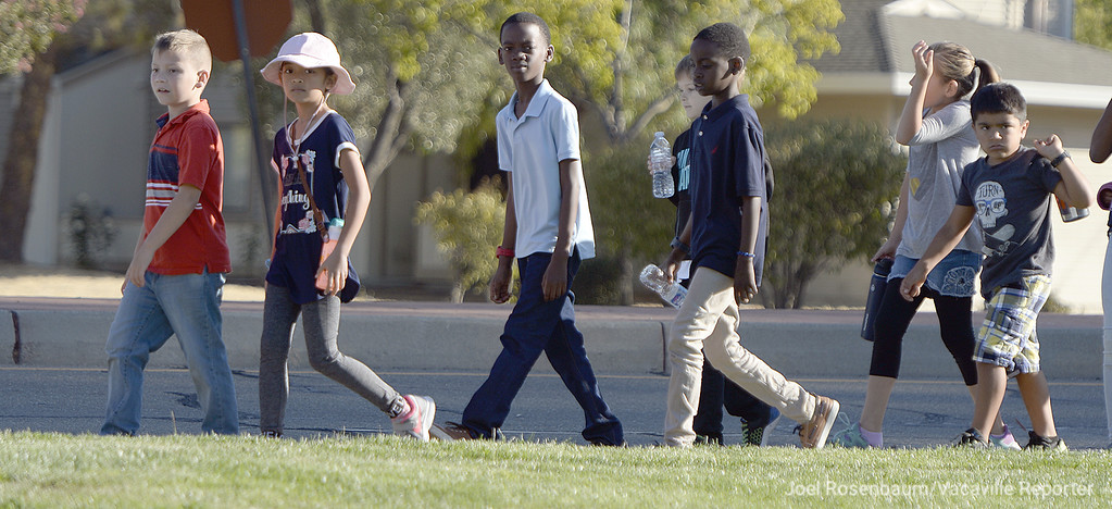 . Studnets from Scandia Elementary School walk along Travis Avenue on Travis Air Force Base toward the Airman and Family Readiness Center Tuesday during the 12th annual Remembrance Walk.
