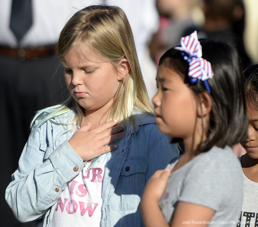 ". Scandia Elementary School third graders, Rylynn Eddelman, 9 (left) and Cayla Park 3 place their hand over their hearts as ""Taps\"" is played over the base\'s public address system at 8:46 a.m  to mark when the time when American Airlines Flight 11 crashed into the North Tower of he World Trade Center 9/11."