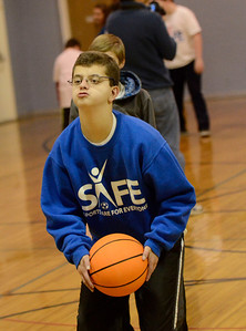 Ed Burke - The Saratogian 01/18/14 Fifteen year old Paul Eaves of Clifton Park lines up a free throw during the SAFE basketball program Saturday at Okte Elementary School in Clifton Park. Sports Are For Everyone (SAFE) officially partnered with the Navy during a ceremony Saturday at the school. SAFE was founded in 1992 by Jim Fitzgerald to ensure those with special needs were able to participate in sports and build friendships and self-confidence.