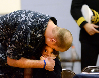 Ed Burke - The Saratogian 01/18/14 Navy Hull Technician Chris Merrow gives his five year old daughter Serenity a kiss during ceremonies Saturday at Okte Elementary School in Clifton Park. Sports Are For Everyone (SAFE) officially partnered with the Navy during a ceremony Saturday at the school. SAFE was founded in 1992 by Jim Fitzgerald to ensure those with special needs were able to participate in sports and build friendships and self-confidence. Merrow is assigned to the Navy's Nuclear Power Training Unit in Ballston Spa.