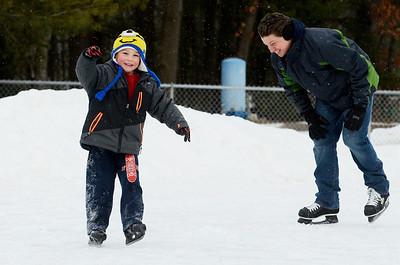 Erica Miller @togianphotog- The Saratogian,   At the Gavin Park ice skating rink, on Monday Jan. 20th, 2014, Max Sawicz, 5 years old, skates on his own as his father follows, Michael Sawicz, on their day off from school, Martin Luther King's Day's remembrance.