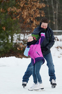 Erica Miller @togianphotog- The Saratogian,   At the Gavin Park ice skating rink, on Monday Jan. 20th, 2014,  Michael Sawicz twirls his daughter Macy, 7 years old, on their day off from school, Martin Luther King's Day's remembrance.