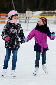 Erica Miller @togianphotog- The Saratogian,   At the Gavin Park ice skating rink, on Monday Jan. 20th, 2014,  Macy Sawicz, 7 years old, skates with friend Jenna Hart, 8 years old, on their day off from school, Martin Luther King's Day's remembrance.