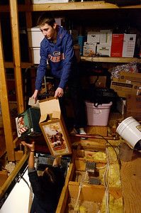 Erica Miller @togianphotog- The Saratogian,   Thomas Hulbert, 15 year old Soph at Shenendehowa, hands Liana Sinnott, 17 year old Jr at Saratoga, empty boxes as they empty the attic at Shelters of Saratoga. Monday Jan. 20th, 2014, in celebration of Martin Luther Kings Day, the community gathered to help local non-for-profits in the city.