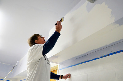 Erica Miller @togianphotog	- The Saratogian,   Mark Huibregtse, from Saratoga, paints the walls at Saratoga Senior Center. Monday Jan. 20th, 2014, in celebration of Martin Luther Kings Day, the community gathered to help local non-for-profits in the city.