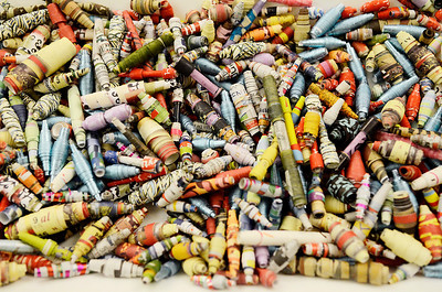 Erica Miller @togianphotog- The Saratogian,   At the Saratoga Springs Public Library, Monday Jan. 20th, 2014, in celebration of Martin Luther Kings Day, the community gathered to help local non-for-profits in the city. On the children's floor they made beads to help provide water to families in Tanzaria. They make paper beads and with every 20 beads made, someone at a school or village will gain access to safe water.