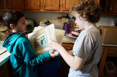 Erica Miller @togianphotog	- The Saratogian,   Jeffery Koeferl, 10 years old from Clifton Park, helps take tupperware lids from Joey Cunanan (left), 8 years old from Clifton Park, while they organized the cabinets at Shelters of Saratoga. Monday Jan. 20th, 2014, in celebration of Martin Luther Kings Day, the community gathered to help local non-for-profits in the city.