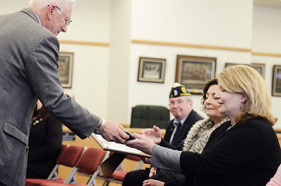 Erica Miller @togianphotog	- The Saratogian,   Saratoga County Board of Supervisor Chairman Paul Sausville, Malta Supervisor, gave Tracy Egan awards in honor of her late father William Wilson Egan. Egan was honored during the monthly, Tuesday Jan 21, 2014, for the County Deceased Veteran's Ceremony.