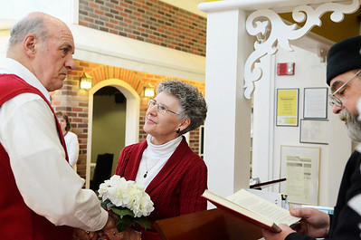 Erica Miller @togianphotog - The Saratogian: 2/25/14    At the Beacon Pointe Memory Care Community in Clifton Park, father John Henry of St. George's Episcopal Church was honored to renew wedding vows with three couples. Harry and Lynn Christie, Harry a resident, celebrated 44 years of marriage this year.