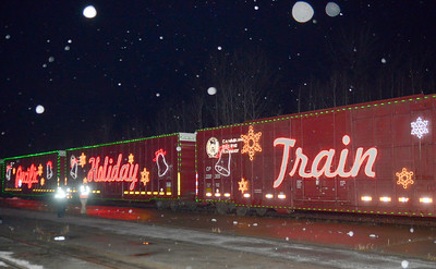 Ed Burke - The Saratogian 11/27/13 A light snow falls as the Canadian Pacific Holiday Train pulls into Saratoga Springs.