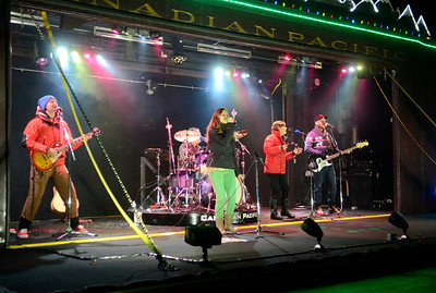 The Claytones perform from the stage car during the Wednesday evening visit to Saratoga Springs by the Canadian Pacific Holiday Train.