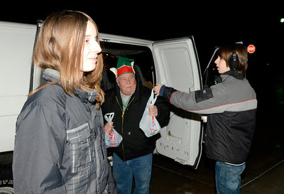 Ed Burke - The Saratogian11/27/13  Brothers Dragan, right, and Zane Carril of Ballston Spa drop off food at the EOC van during Wednesday's visit by the Canadian Pacific Holiday Train.