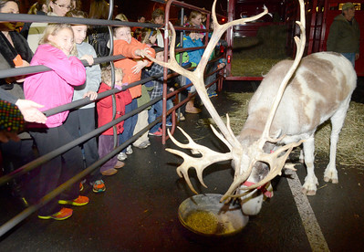 Ed Burke - The Saratogian 12/5/13 Crowds gather to see a reindeer during Thursday's Victorian Streetwalk in downtown Saratoga Springs.
