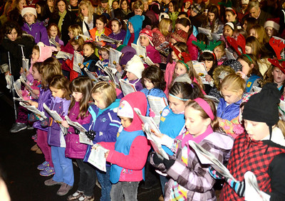 Ed Burke - The Saratogian 12/5/13 Area Girl Scouts gather to sing holiday songs during Thursday's Victorian Streetwalk in downtown Saratoga Springs.
