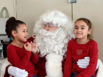 Ed Burke - the Saratogian 12/21/13 As seven year old Jalen Pearsall smirks at right, six year old Zanaiyah Lockridge tells Santa what she wants for Christmas Saturday at Saratoga Springs Recreation Center during a party with Santa for children from Vanderbilt and Jefferson Terrace. The event provided gifts for the children and was sponsored by Junior Chamber International.