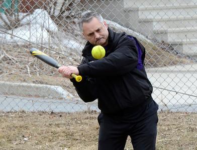 Ed Burke - The Saratogian 04/01/14 Coach Ed Lenz hits balls Tuesday during Saratoga Central Catholic varsity softball practice.