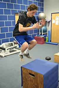 Eric Jenks - The Saratogian Tyler Lisieski during an off season training session at Torres XTF Health and Fitness in Ballston Lake Wednesday, August 6th, 2014.