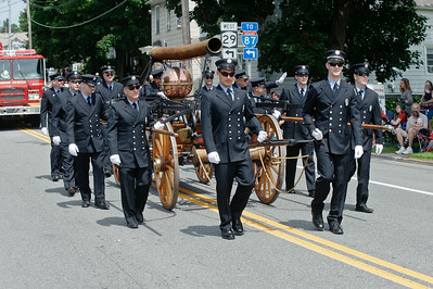 Eric Jenks - The Saratogian Members of the Schuylerville Hose Company show off an 1850's piece of firefighting machinery during the Schuylerville Turning Point Parade Sunday, August 3, 2014.