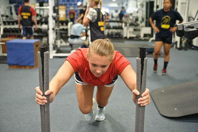 Eric Jenks - The SaratogianRosalie Pizziketti pushes weights around during an off season training session at Torres XTF Health and Fitness in Ballston Lake Wednesday, August 6th, 2014.