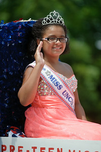 Eric Jenks - The Saratogian Pre-Teen Miss Uncle Sam Jada Rondon waves to the crowd during the Schuylerville Turning Point Parade Sunday, August 3, 2014.