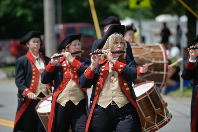 Eric Jenks - The Saratogian Members of the Moodus Drum & Fife Corps. from Moodus Connecticut perform in the Schuylerville Turning Point Parade Sunday, August 3, 2014.