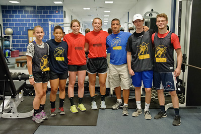 Eric Jenks - The Saratogian Personal trainer Steve Hart (Center Blue) poses with some of his student athletes during an off season training session at Torres XTF Health and Fitness in Ballston Lake Wednesday, August 6th, 2014.