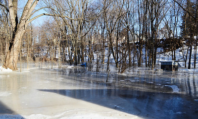 Erica Miller @togianphotog - The Saratogian.    Ice in the Kayaderosseras Creek has flooded Kelley Park in Ballston Spa on Wednesday, Jan. 8th, 2013, for the second time this winter according to neighbors. The bridge crossing over the creek on Ralph Street has be shut down with concerns for damage to the bridge. The overflow of ice has been creeping up to homes on Mechanic Street, flooding basement homes.SAR-l-IceJam8