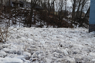 Erica Miller @togianphoto - The Saratogian, Ice in the Kayaderosseras Creek has flooded Kelley Park in Ballston Spa on Monday, Jan. 13th, 2013, for the second time this winter according to neighbors. The bridge crossing over the creek on Ralph Street has be shut down with concerns for damage to the bridge and now to the sewer and gas pipes. The overflow of ice has been creeping up to homes on Mechanic Street, flooding basement homes on Ralph Street.