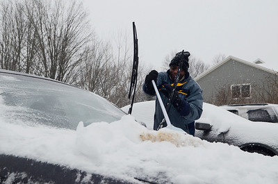 Erica Miller @togianphotog - The Saratogian:     Resident in Vanderbilt Terrace Arron Ford cleaned off his car, in worries the snow may pile up, on Wednesday morning, February 5th, 2014, the beginning of the snow storm hitting the North Eastern area. Snow will continue to fall till early evening.